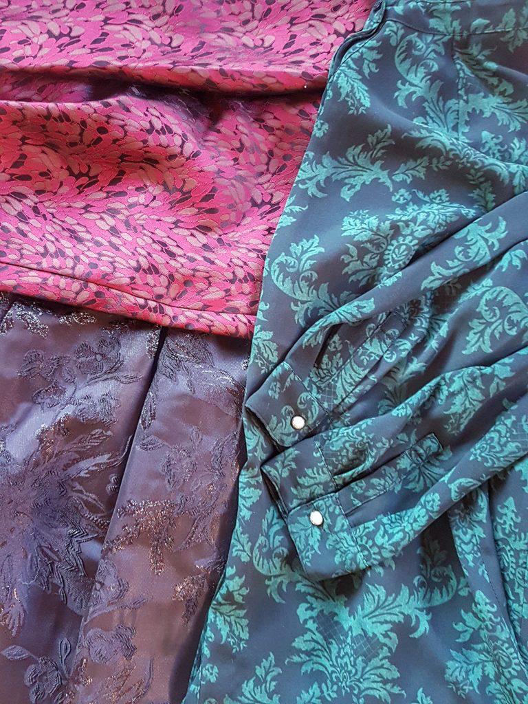 Damask and taffeta fabric close up