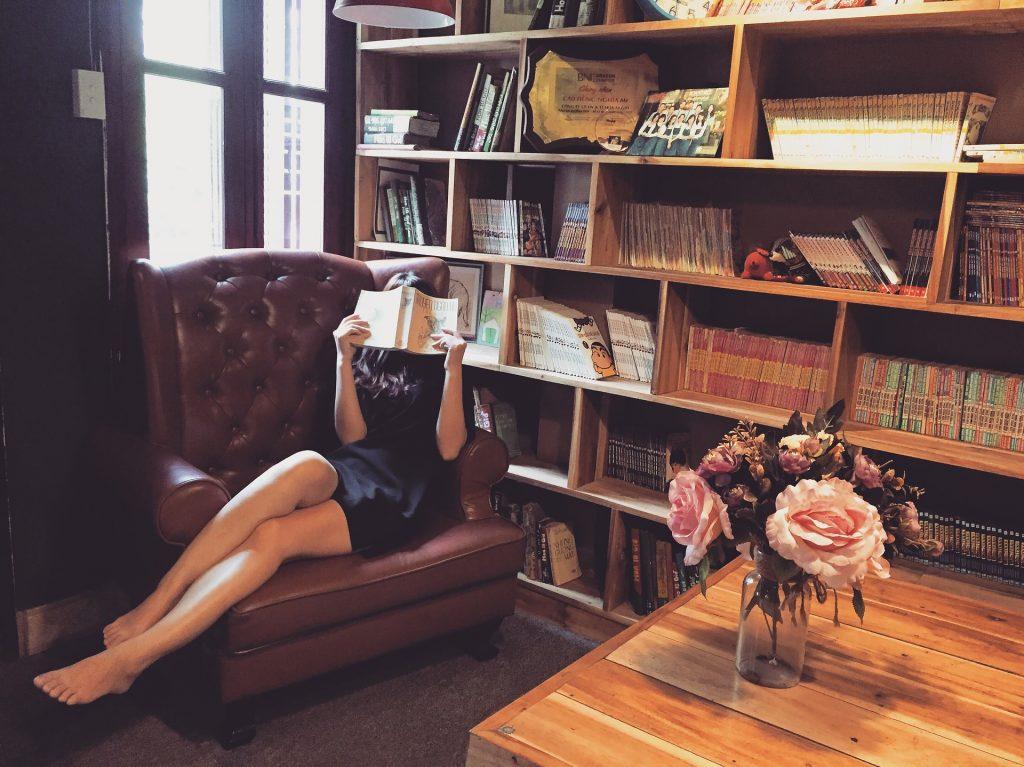 Woman reading in her home library