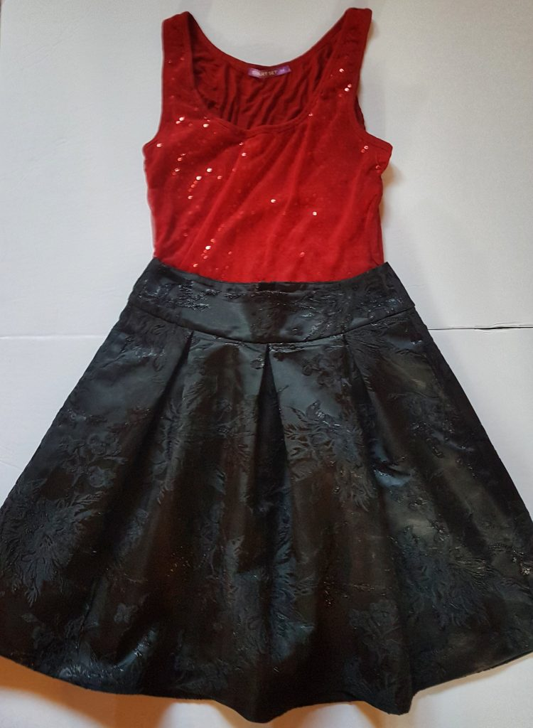Red sequined tank top with black full skirt