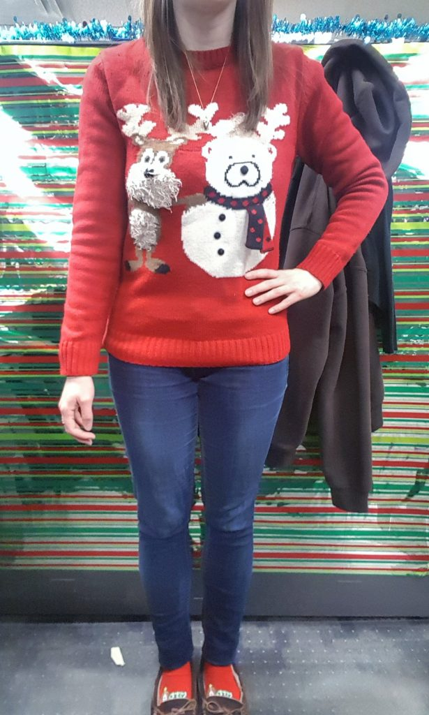 Casual outfit of the day with jeans and ugly Christmas sweater